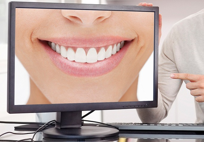 close up of smile on computer screen