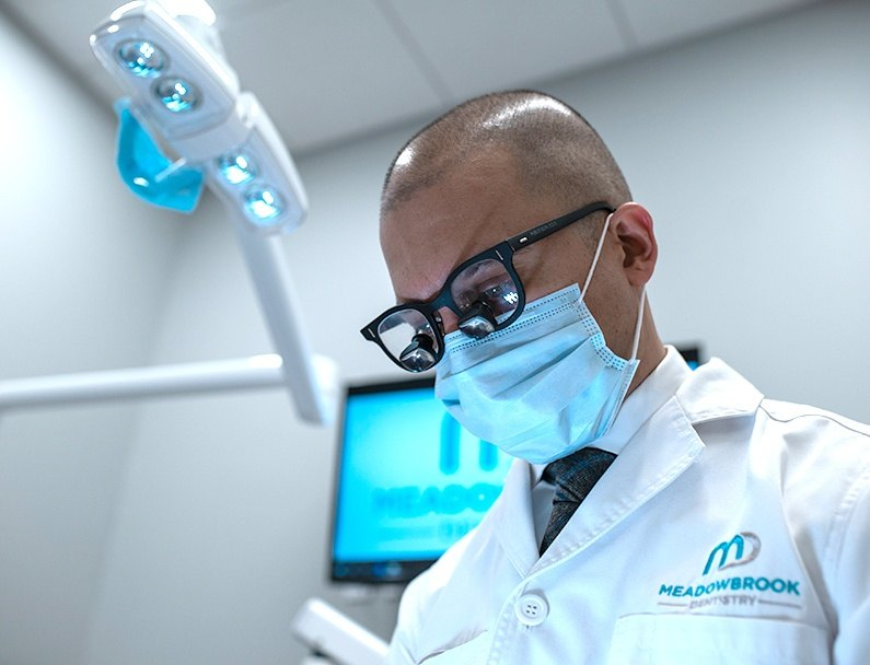 plainview dentist focused with glasses and mask on