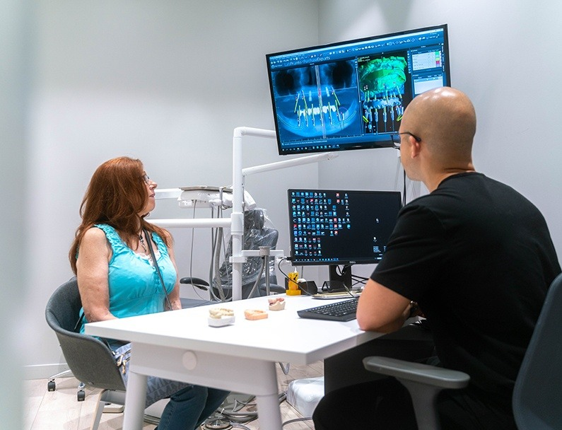 Plainview Dentist showing patient her x-rays