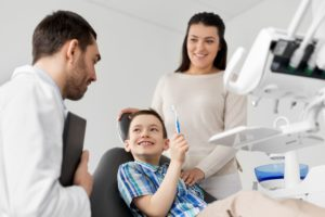 young boy and mother at dentist
