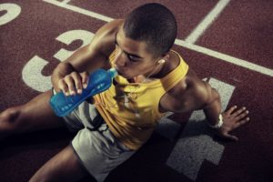 athlete drinking a sports drink